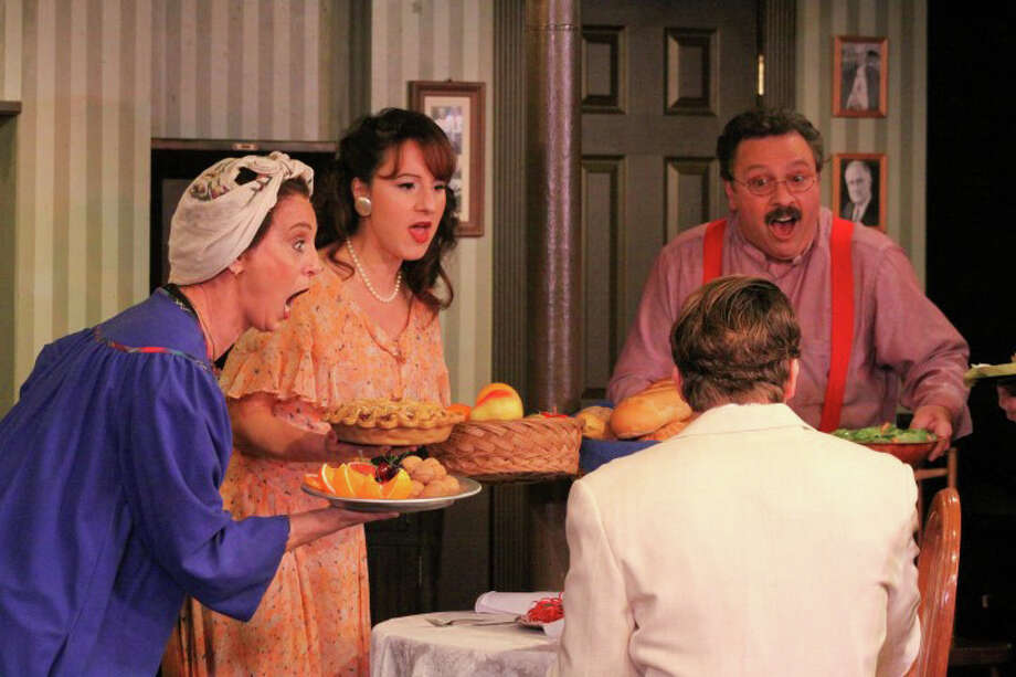 "The role of food in Italian American family life is depicted in the musical number ""Pasta Pushin' Mama"" in ""A Merry Mulberry Street Musical"" at Curtain Call theater in Stamford through Dec. 16. Shown here are (left to right) Gail Yudain, Dana DiCerto, and Lou Ursone. In the foreground is Joe Efferen. Photo: Contributed Photo"