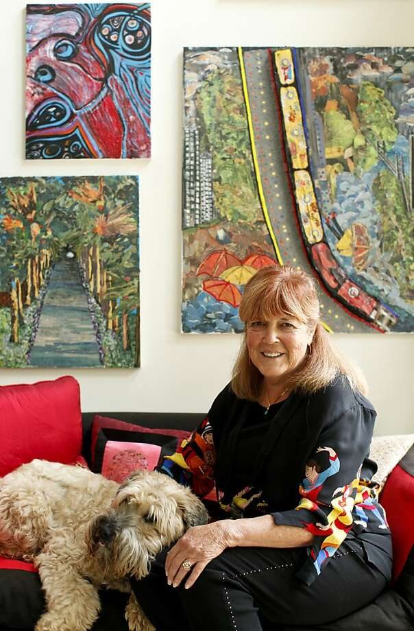 "Angi Shine, seen with her dog, Bailey on Wednesday, Sep. 5, 2012 in Belmont, Calif., makes ""paintings' from color newsprint from the Chronicle. Photo: Russell Yip, The Chronicle"