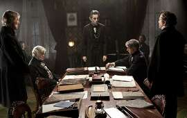 "FILE - This undated publicity photo released by DreamWorks and Twentieth Century Fox, shows Daniel Day-Lewis, center rear, as Abraham Lincoln, in a scene from the film, ""Lincoln."" Leaving nothing to chance, Daniel Day-Lewis' prep for his movie role as Abraham Lincoln included the two-time Academy Award winner secretly spending time in the 16th U.S. president's former Illinois turf. (AP Photo/DreamWorks, Twentieth Century Fox, David James, File)"