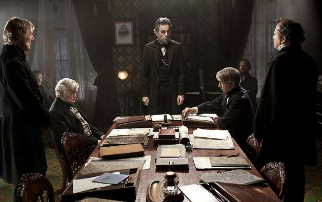 "FILE - This undated publicity photo released by DreamWorks and Twentieth Century Fox, shows Daniel Day-Lewis, center rear, as Abraham Lincoln, in a scene from the film, ""Lincoln."" Leaving nothing to chance, Daniel Day-Lewis' prep for his movie role as Abraham Lincoln included the two-time Academy Award winner secretly spending time in the 16th U.S. president's former Illinois turf. (AP Photo/DreamWorks, Twentieth Century Fox, David James, File) Photo: David James, Associated Press"