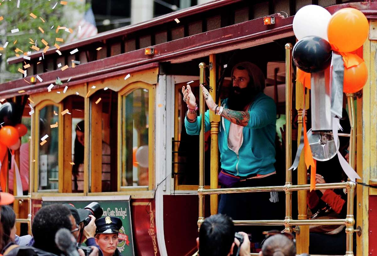 San Francisco Giants pitcher Brian Wilson rides in a cable car during the baseball team's World Series victory parade, Wednesday, Oct. 31, 2012, in San Francisco.