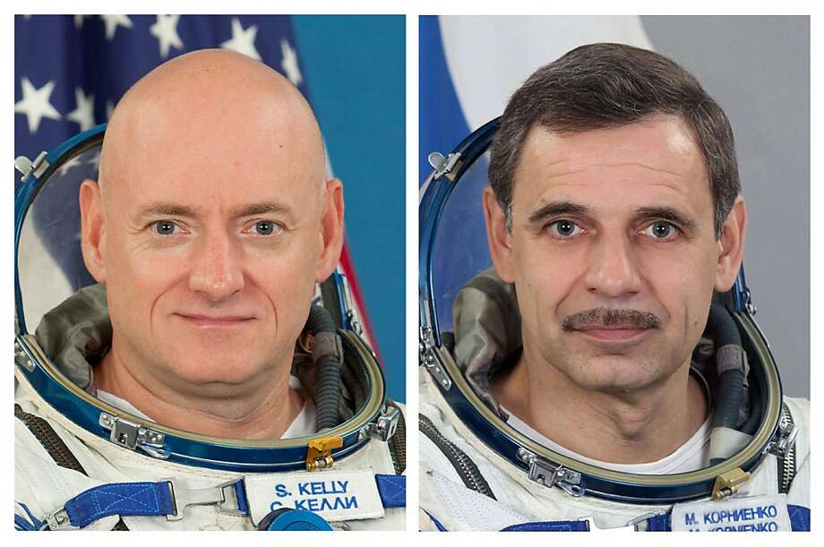U.S. astronaut Scott Kelly, left, and Russian cosmonaut Mikhail Kornienko will begin the extended stay aboard the International Space Station in 2015. Photo: Associated Press