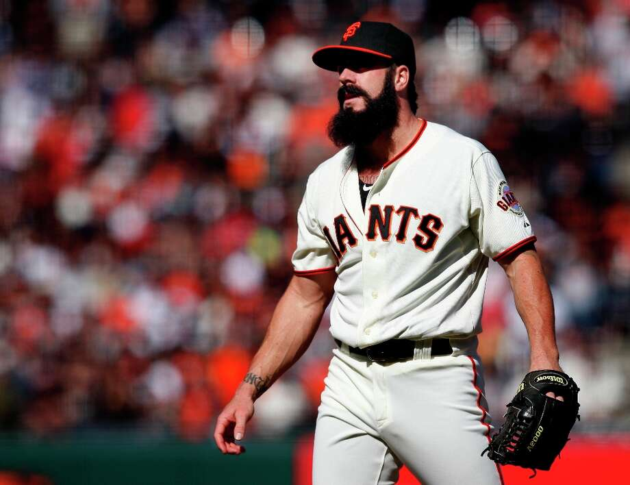 Giants closer Brian Wilson watches as Atlanta players cross home plate in the tenth inning Sunday. Photo: Brant Ward, The Chronicle / SFC