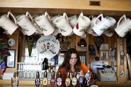 Karen Blackwell, daughter of owner Peter Blackwell, pours a beer at the bar at English Ales Brewery and Cafe in Marina, Calif., Tuesday, November 20, 2012.