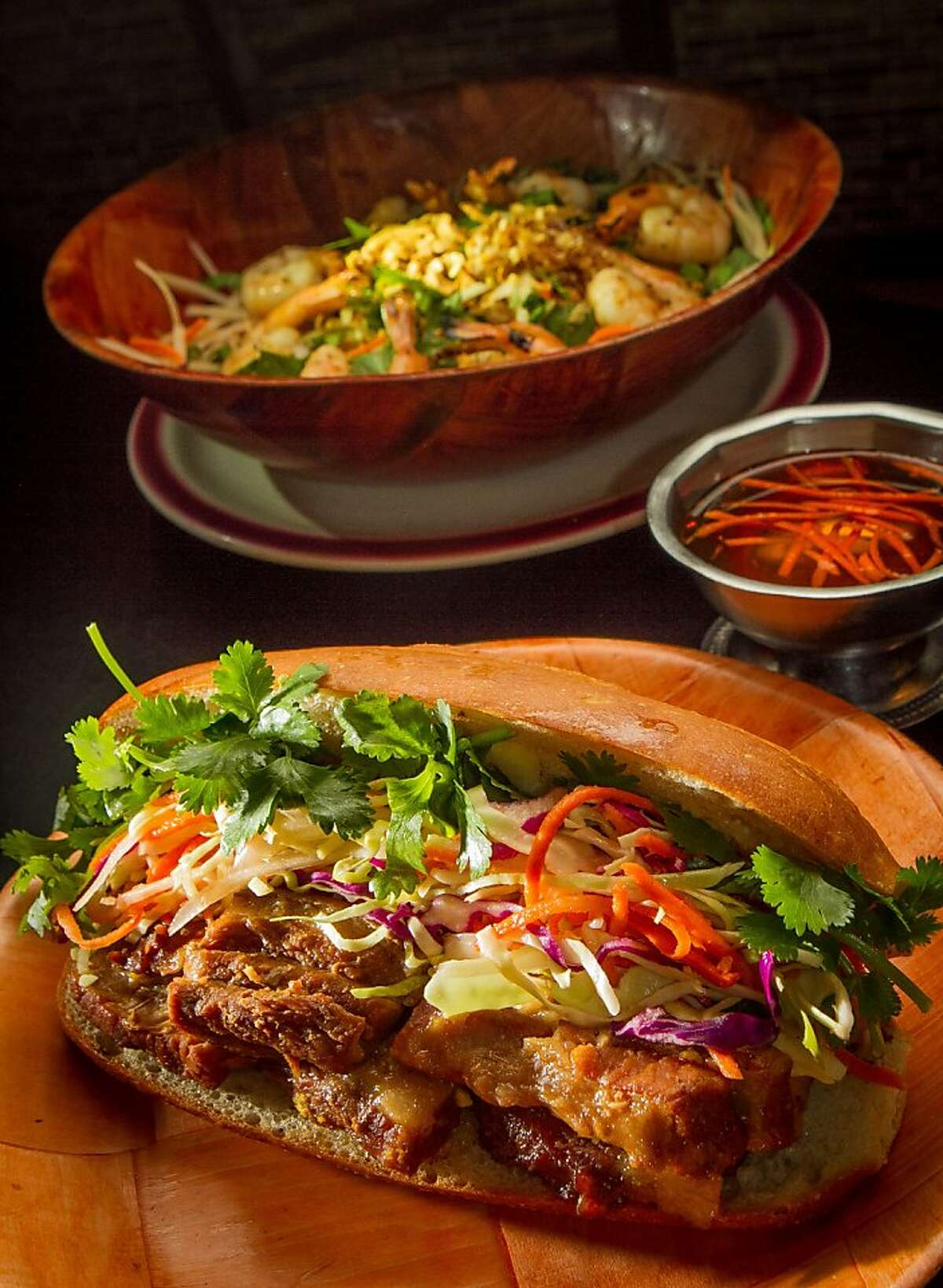 The Pork Belly Sandwich and the Papaya Salad at Cafe Bunn Mi in San Francisco, Calif., is seen on Tuesday, November 20th, 2012.
