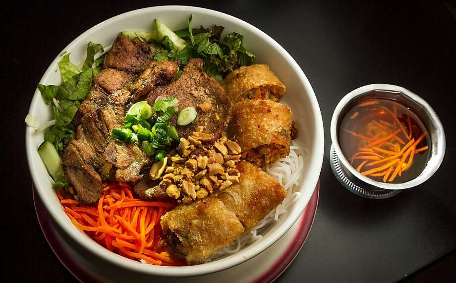 Bring a modest amount of cash to Cafe Bunn Mi in San Francisco's Inner Richmond neighborhood and order the grilled pork Saigon noodles, or maybe try the papaya salad or the pork belly sandwich. Photo: John Storey, Special To The Chronicle
