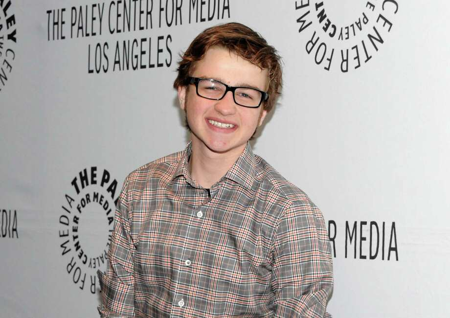 "FILE - In this March 12, 2012 file photo, actor Angus T. Jones arrives at the Paleyfest panel discussion of the television series ""Two and a Half Men"" in Beverly Hills, Calif. Jones, the teenage actor who plays the half in the hit CBS comedy ""Two and a Half Men"" says it's ""filth"" and through a video posted by a Christian church has urged viewers not to watch it. (AP Photo/Dan Steinberg, File) Photo: Dan Steinberg, Associated Press / R-STEINBERG"