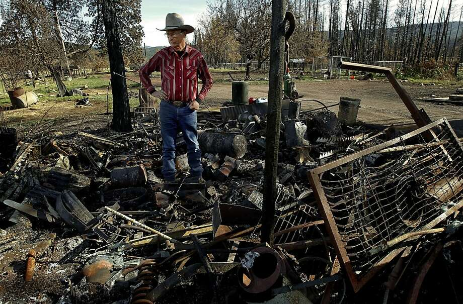 Hank Pritchard stands in the middle of what used to be structures on his family's ranch in Tehama County. The Ponderosa Fire in August blazed through the property, where he has lived all his life. Photo: Michael Macor, The Chronicle