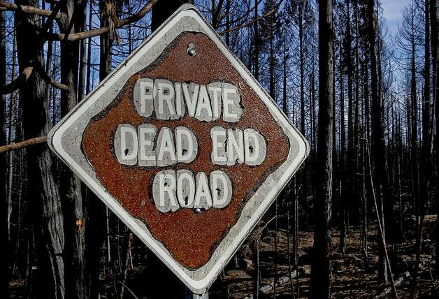 Burned trees and a street sign on Friday Nov. 23, 2012, in Manton, Calif., were detroyed during the Ponderosa fire last August 2012. A tough fire season in California just officially wrapped up last week, and Cal Fire is prepping for winter mode. But some homeowners are still dealing with rebuilding months after their houses were burned in some destructive fires during a particularly challenging season fueled by dry grasses after a record dry winter. Photo: Michael Macor, The Chronicle