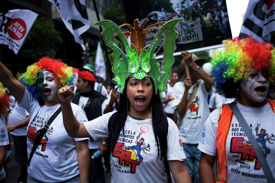 Protesters march Monday in Rio de Janeiro against an energy-revenue sharing plan in Brazil. Photo: Victor R. Caivano, STF / AP