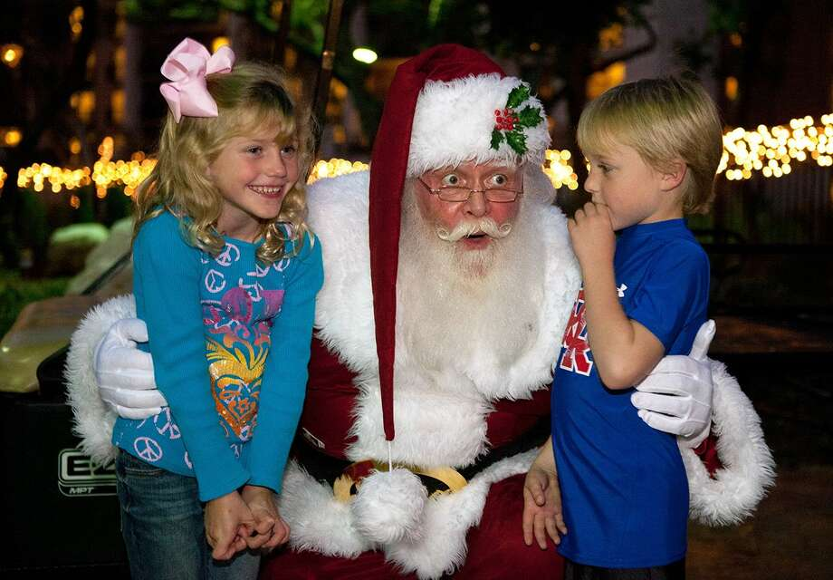 Santa hears the wish list of two visitors at the San Antonio J.W. Marriott Hill Country Resort & Spa. The resort is offering a variety of holiday activities for kids and families in December. Photo: San Antonio Express-News