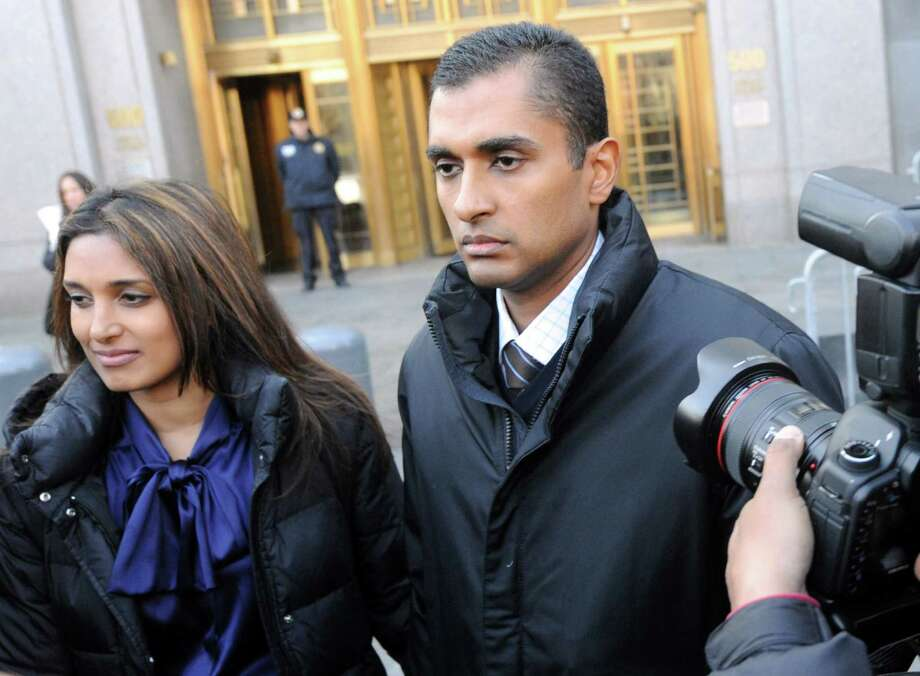 Former hedge fund worker Mathew Martoma leaves Manhattan court Monday with his wife, Rosemary. Photo: Louis Lanzano, FRE / FR77522 AP