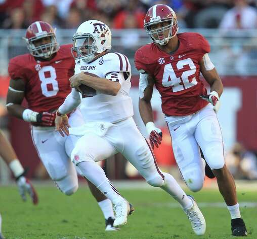 Texas A&M quarterback Johnny Manziel (2) scrambles for yardage during the first quarter of a college football game at Bryant-Denny Stadium, Saturday, Nov. 10, 2012, in Tuscaloosa.  ( Karen Warren / Houston Chronicle ) Photo: Karen Warren, Staff / © 2012  Houston Chronicle