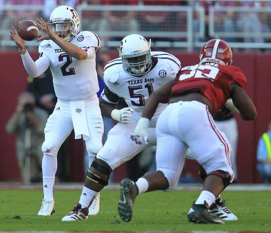 Texas A&M quarterback Johnny Manziel (2) takes a snap during the first quarter of a college football game at Bryant-Denny Stadium, Saturday, Nov. 10, 2012, in Tuscaloosa.  ( Karen Warren / Houston Chronicle ) Photo: Karen Warren, Staff / © 2012  Houston Chronicle