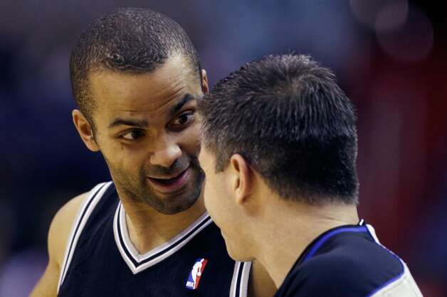 The Spurs' Tony Parker (9) questions a call by referee Eli Roe  on Monday in Washington. (Rob Carr / Getty Images)