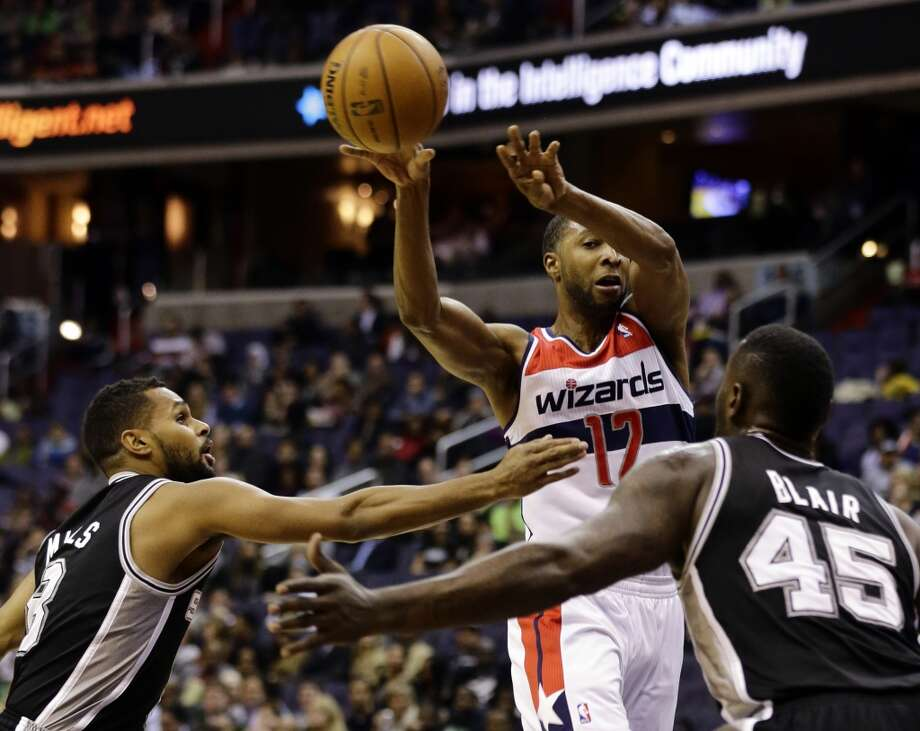 Spurs guard Patty Mills (8) and center DeJuan Blair (45) guard Wizards guard A.J. Price (12) as he passes the ball  on Monday in Washington. (Alex Brandon / Associated Press)