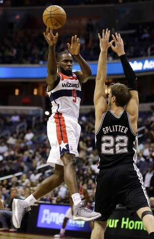 Wizards forward Martell Webster passes the ball in front of Spurs forward Tiago Splitter  on Monday in Washington. (Alex Brandon / Associated Press)
