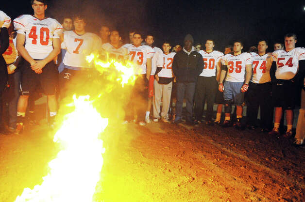 "The Greenwich High School football team holds its annual ""Burning of the Shoes"" ceremony at the school in Greenwich, Conn., Nov. 26, 2012. The tradition is meant to symbolize the transition of seniors out of the football program, burning their shoes demonstrates that their shoes can never be filled. Photo: Keelin Daly / Stamford Advocate Riverbend Stamford, CT"