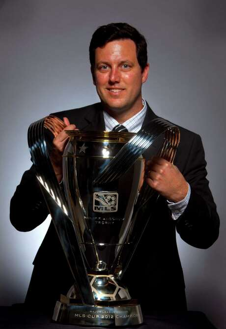 Dynamo president Chris Canetti has a firm grip on the MLS Cup trophy. He hopes to have that same grip on the prize Saturday after the Dynamo play the Galaxy. Photo: Billy Smith II, Staff / © 2012 Houston Chronicle