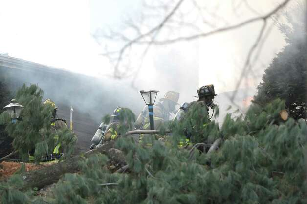 Firefighters battle a house fire on Garfield Road on Monday, Nov. 26, 2012 in Eagle Mills, N.Y.  (Paul Buckowski / Times Union) Photo: Paul Buckowski