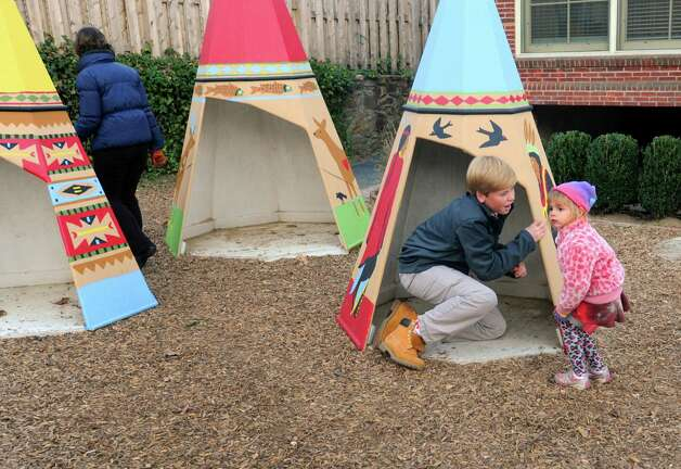 "Brunswick student volunteer Gus Fraser plays in the teepees with Eva Marie Barber at Family Centers Arch Street Preschool in Greenwich, Conn. on Monday Nov. 26, 2012. Residents, companies and charities across the country are celebrating Tuesday Nov. 27th as ""Giving Tuesday,"" an inaugural national day of service, urging folks to spend the day giving back to their community. Photo: Cathy Zuraw / Greenwich Time"