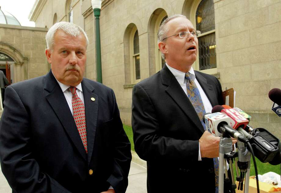 Rensselaer County Legislator Robert Mirch, cq., left, and Troy City Counsel member Henry Bauer, right, hold a press conference outside the Rensselaer County Court House on Monday, Sept. 28, 2009, in Troy, NY.  The presser held by the Republicans, was to denounce the alleged faking of absentee ballots as special prosecutor Trey Smith prepares to examine the ballots in a local Working Families Party primary.   (Luanne M. Ferris / Times Union) Photo: LUANNE M. FERRIS / 00005708A