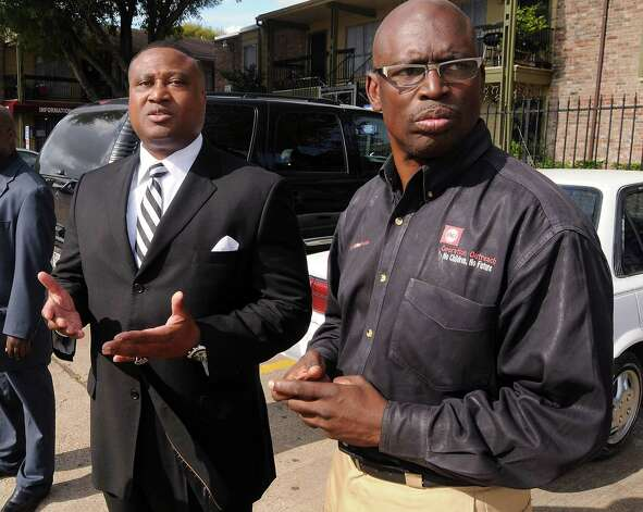 Quanell X, left, discusses his meeting with Rock Springs apartment management over fliers asking tenants to report young black males. Photo: Dave Rossman, Freelance / © 2012 Dave Rossman