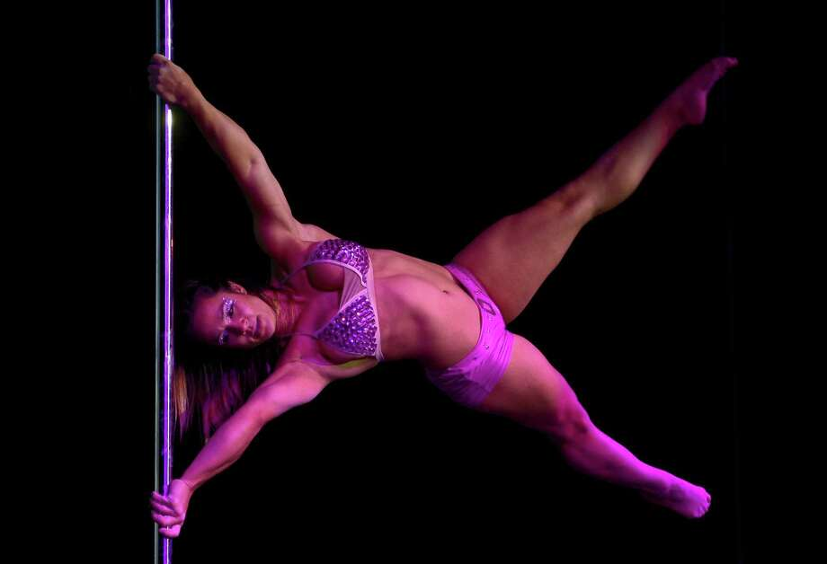 Brazilian pole dancer Rafaela Montanaro competes in the Miss Pole Dance South America 2012 competition in Buenos Aires on November 26, 2012. Montanaro won the event as well as the Best Pole Trick trophy. AFP PHOTO / Juan MabromataJUAN MABROMATA/AFP/Getty Images Photo: JUAN MABROMATA, AFP/Getty Images / AFP