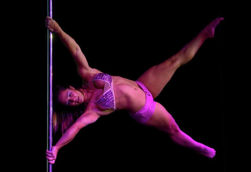 Brazilian pole dancer Rafaela Montanaro competes in the Miss Pole Dance South America 2012 competiti