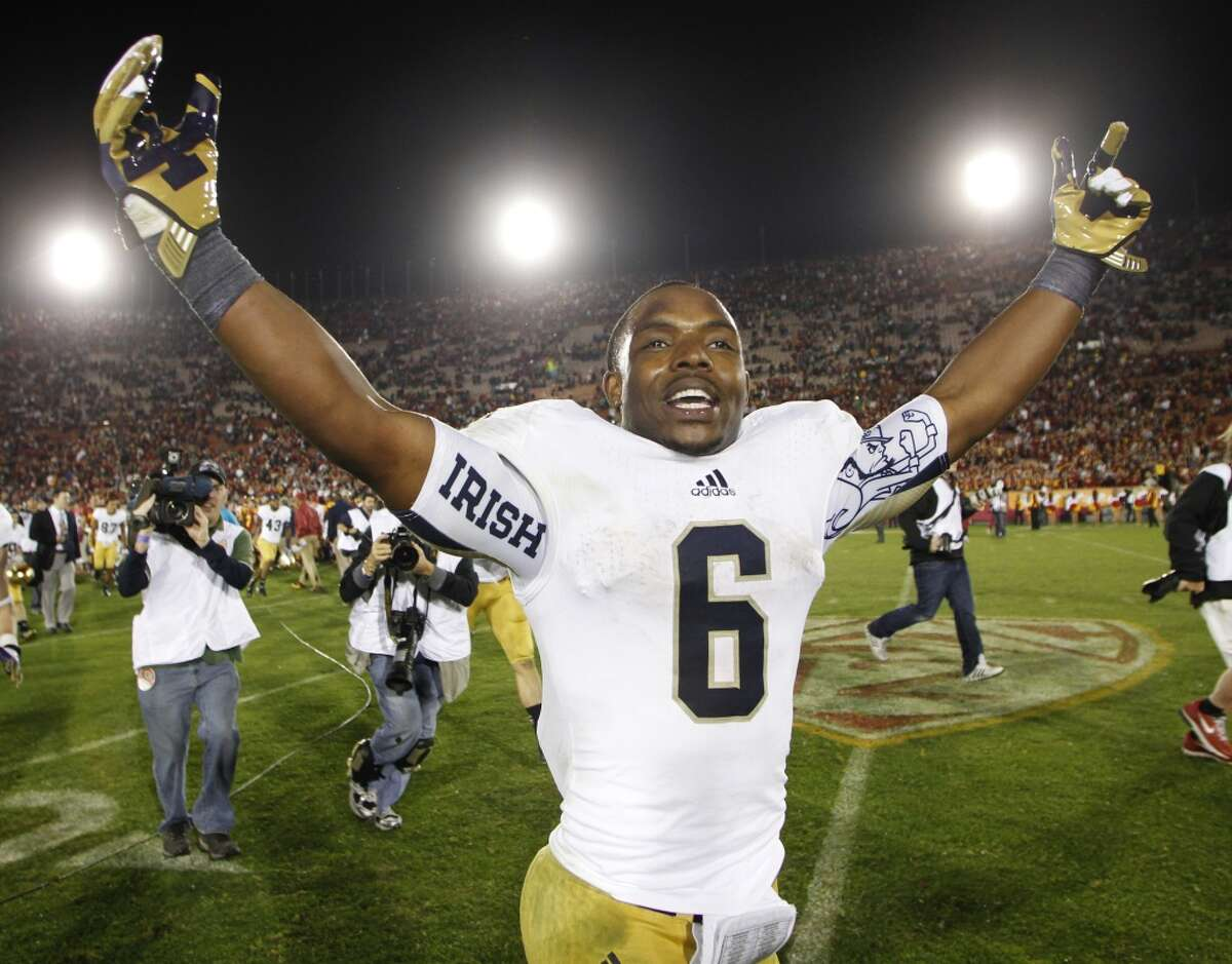 BCS title game: Notre Dame (BCS No. 1) vs. Alabama (BCS No. 2) -- Notre Dame running back Theo Riddick celebrates after Saturday's victory over USC. (Danny Moloshok / Associated Press)