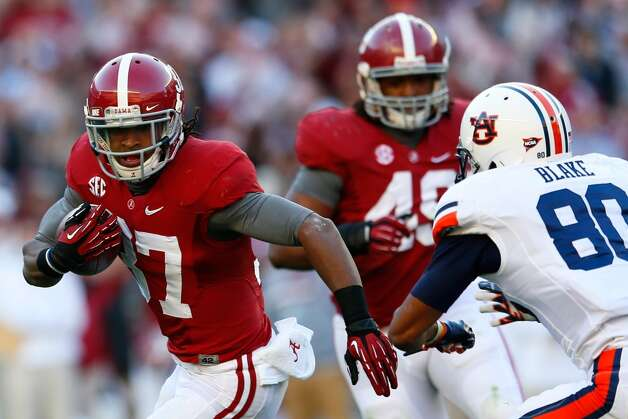 BCS title game: Notre Dame (BCS No. 1) vs. Alabama (BCS No. 2) -- Robert Lester (37) of  Alabama returns an interception against Auburn.  (Kevin C. Cox / Getty Images)