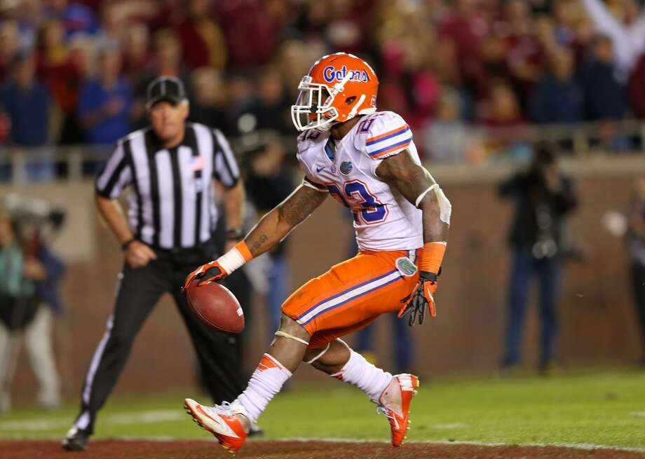 Sugar: Florida (SEC at-large) vs. Louisville (Big East champion)   --  Florida's Mike Gillislee scores a touchdown against Florida State.  (Mike Ehrmann / Getty Images)
