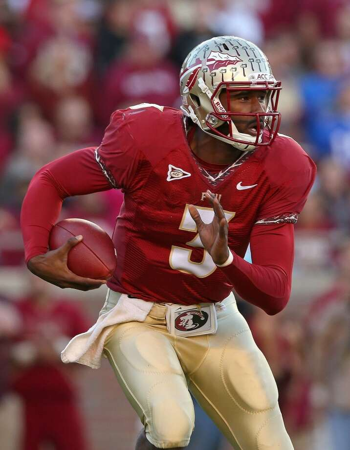 Orange: Florida State (ACC champ) vs. Kent State (BCS at-large) -- Florida State quarterback  EJ Manuel scrambles against Florida.  (Mike Ehrmann / Getty Images)