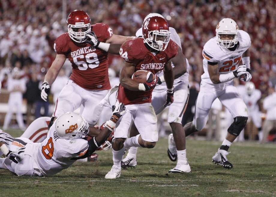Cotton: Oklahoma (Big 12 No. 2) vs. LSU (SEC)  --  Oklahoma running back Brennan Clay breaks a run against Oklahoma State.  (Sue Ogrocki / Associated Press)