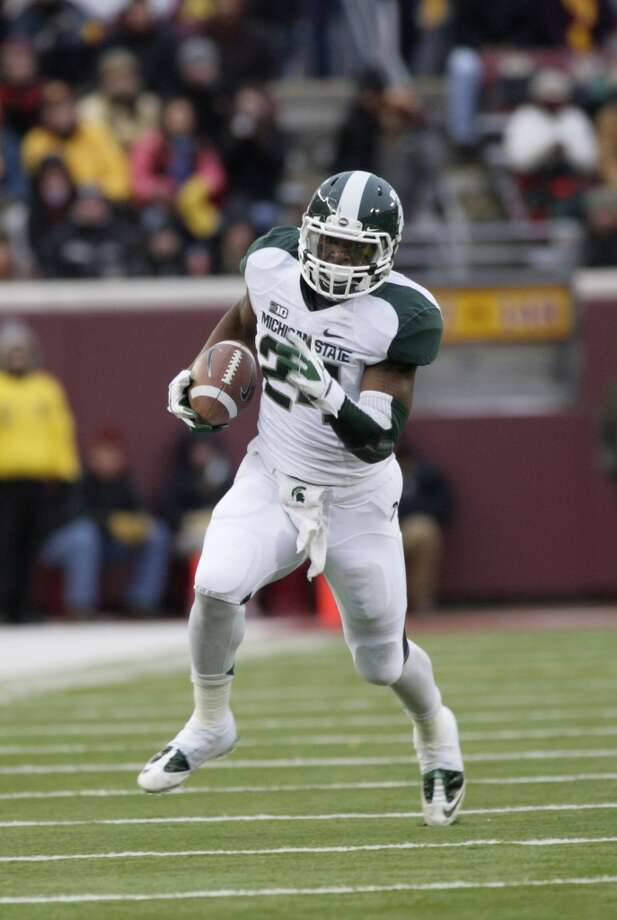 Buffalo Wild Wings: Oklahoma State (Big 12 No. 4) vs. Michigan State (Big Ten No. 4/5)   --  Michigan State running back Le'Veon Bell carries the ball against Minnesota.  (Paul Battaglia / Associated Press)