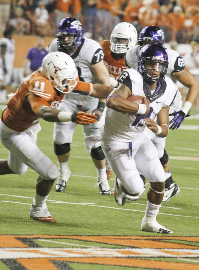 Holiday: TCU (Big 12 No. 5) vs. UCLA (Pac-12 No. 3) -- TCU quarterback Trevone Boykin carries the ball against Texas.    (Jack Plunkett / Associated Press)