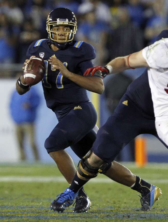 Holiday: TCU (Big 12 No. 5) vs. UCLA (Pac-12 No. 3) -- UCLA quarterback Brett Hundley looks for a receiver against Stanford.  (Alex Gallardo / Associated Press)