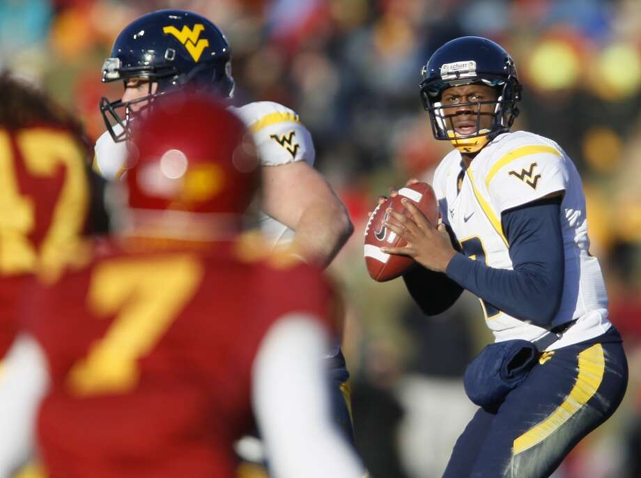 Pinstripe: West Virginia (Big 12 No. 7) vs. Pittsburgh (Big East No. 4) -- West Virginia quarterback Geno Smith looks for a receiver against Iowa State.    (Matthew Putney / Associated Press)