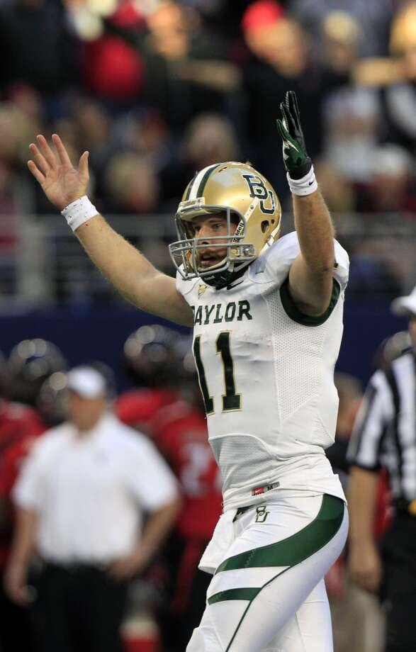 Heart of Dallas: Baylor (Big 12 No. 8) vs. Purdue (Big Ten No. 7) -- Baylor quarterback Nick Florence celebrates a touchdown pass against Texas Tech.    (LM Otero / Associated Press)