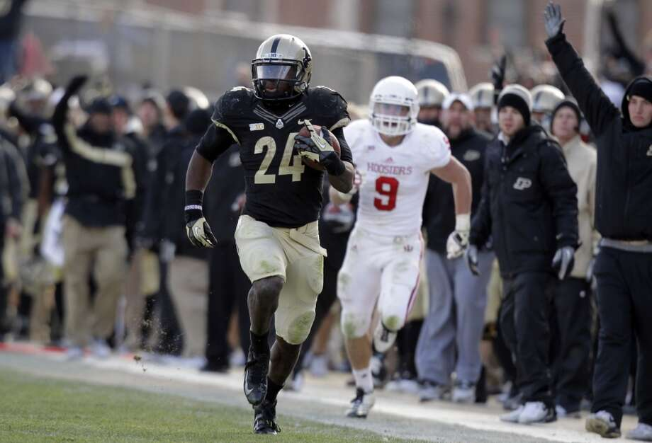 Heart of Dallas: Baylor (Big 12 No. 8) vs. Purdue (Big Ten No. 7) -- Purdue running back Akeem Shavers breaks a touchdown run against Indiana.  (Michael Conroy / Associated Press)