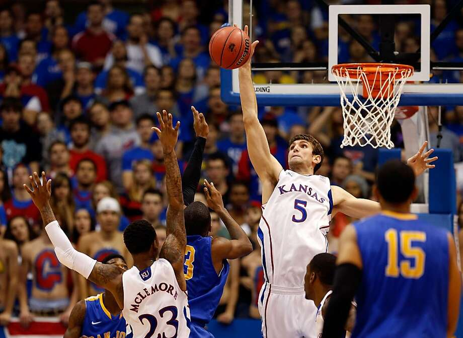 Jeff Withey of Kansas blocks a shot by San Jose State's James Kinney. Withey finished with 12 blocks and a triple-double. Photo: Jamie Squire, Getty Images