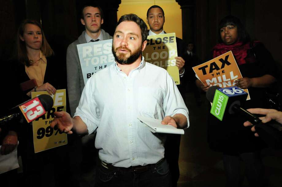 Colin Donnaruma of Occupy Albany reacts to tax breaks for the wealthy on Wednesday, March 28, 2012, at the Capitol in Albany, N.Y. (Cindy Schultz / Times Union archive) Photo: Cindy Schultz