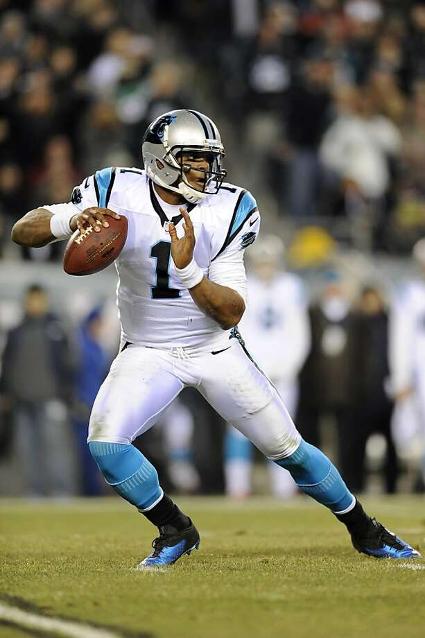 Cam Newton had a hand in four Carolina touchdowns. Photo: Michael Perez, Associated Press
