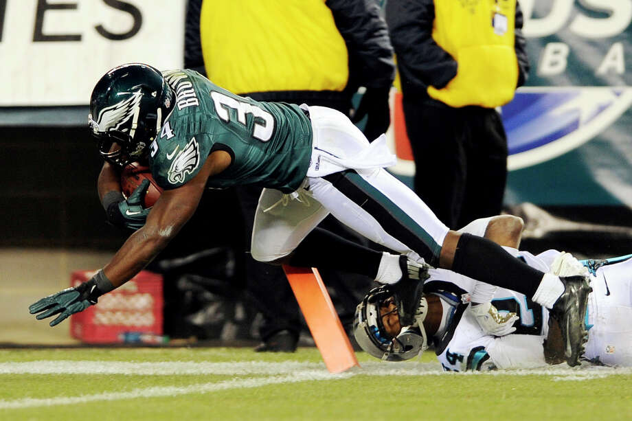 Philadelphia Eagles running back Bryce Brown (34) scores a touchdown as Carolina Panthers cornerback Josh Norman hangs on in the first half of an NFL football game, Monday, Nov. 26, 2012, in Philadelphia. (AP Photo/Michael Perez) Photo: Michael Perez