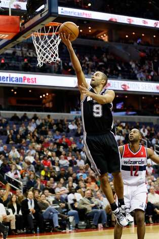 WASHINGTON, DC - NOVEMBER 26:  Tony Parker #9 of the San Antonio Spurs puts up a shot in front of A.J. Price #12 of the Washington Wizards during the second half of the Spurs 118-92 win at Verizon Center on November 26, 2012 in Washington, DC. NOTE TO USER: User expressly acknowledges and agrees that, by downloading and/or using this photograph, user is consenting to the terms and conditions of the Getty Images License Agreement.  (Photo by Rob Carr/Getty Images) (Getty Images)