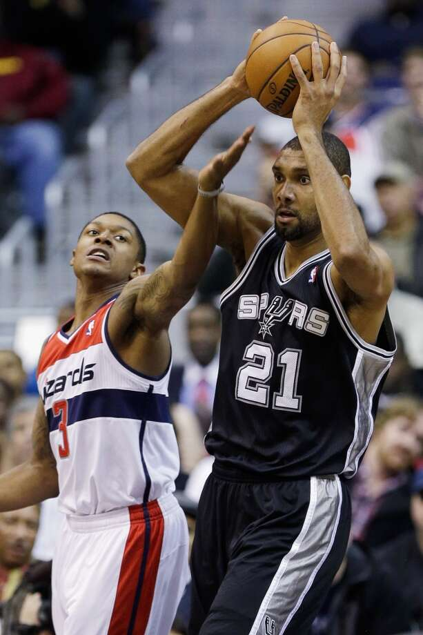 WASHINGTON, DC - NOVEMBER 26: Tim Duncan #21 of the San Antonio Spurs pulls in a rebound in front of Bradley Beal #3 of the Washington Wizards during the second half of the Spurs 118-92 win at Verizon Center on November 26, 2012 in Washington, DC. NOTE TO USER: User expressly acknowledges and agrees that, by downloading and/or using this photograph, user is consenting to the terms and conditions of the Getty Images License Agreement.  (Photo by Rob Carr/Getty Images) (Getty Images)
