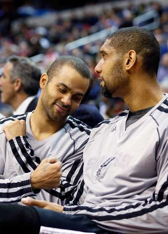 WASHINGTON, DC - NOVEMBER 26: Tony Parker #9 (L) jokes with teammate Tim Duncan #21 of the San Antonio Spurs on the bench during the second half of the Spurs 118-92 win over the Washington Wizards at Verizon Center on November 26, 2012 in Washington, DC. NOTE TO USER: User expressly acknowledges and agrees that, by downloading and/or using this photograph, user is consenting to the terms and conditions of the Getty Images License Agreement.  (Photo by Rob Carr/Getty Images) (Getty Images)