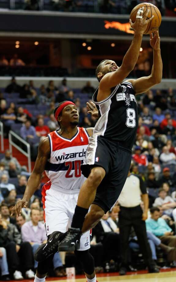 WASHINGTON, DC - NOVEMBER 26: Patrick Mills #8 of the San Antonio Spurs puts up a shot in front of Cartier Martin #20 of the Washington Wizards during the second half at Verizon Center on November 26, 2012 in Washington, DC. NOTE TO USER: User expressly acknowledges and agrees that, by downloading and/or using this photograph, user is consenting to the terms and conditions of the Getty Images License Agreement.  (Photo by Rob Carr/Getty Images) (Getty Images)