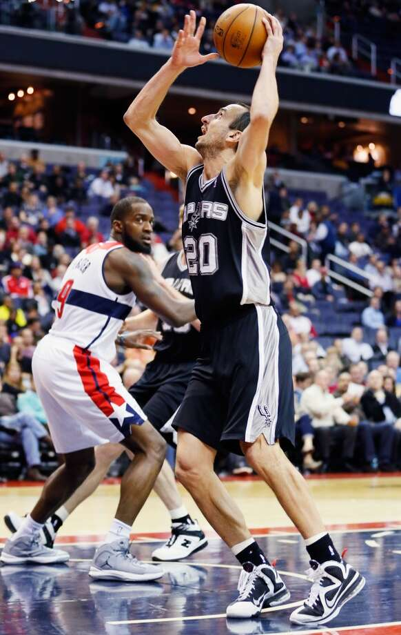 WASHINGTON, DC - NOVEMBER 26: Manu Ginobili #20 of the San Antonio Spurs puts up a shot in front of Martell Webster #9 of the Washington Wizards during the second half of the Spurs 118-92 win at Verizon Center on November 26, 2012 in Washington, DC. NOTE TO USER: User expressly acknowledges and agrees that, by downloading and/or using this photograph, user is consenting to the terms and conditions of the Getty Images License Agreement.  (Photo by Rob Carr/Getty Images) (Getty Images)