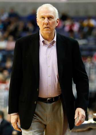 WASHINGTON, DC - NOVEMBER 26: Head coach Gregg Popovich of the San Antonio Spurs walks the sideline during the first half of the Suprs 118-92 win over the Washington Wizards at Verizon Center on November 26, 2012 in Washington, DC. NOTE TO USER: User expressly acknowledges and agrees that, by downloading and/or using this photograph, user is consenting to the terms and conditions of the Getty Images License Agreement.  (Photo by Rob Carr/Getty Images) (Getty Images)